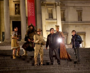 NIGHT AT THE MUSEUM 3 (from left) Sacajawea (Mizuo Peck), Atilla the Hun (Patrick Gallagher), Teddy Roosevelt (Robin Williams), Larry Daley (Ben Stiller) and Nick Daley   (Skyler  Gisondo) plot to save the magic that brought the museum characters to life.  Photo credit:  Kerry Brown. TM and © 2014 Twentieth Century Fox Film Corporation. All Rights Reserved. Not for sale or duplication.